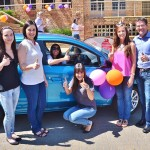 This lucky lady won a brand new Mitsubishi Mirage that was fitted with a Beame tracking device